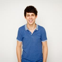 Matt Richardson smiling wearing a blue top